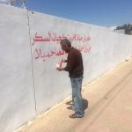 """「戦争」を「愛」で塗り直す。イスラム過激派に解放された街で、ある男性が行った""""平和な落書き""""とは"""